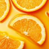 La naranja rebana el fondo Imagen de archivo