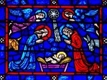 La natività (nascita di Gesù) in vetro stianed immagini stock libere da diritti