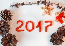 La Navidad adornada en el fondo blanco Foto de archivo