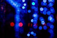 La Navidad azul del mery del bokeh de la guirnalda del juguete de la Navidad Fotos de archivo libres de regalías