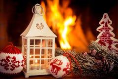 La Navidad cerca de la chimenea Fotografía de archivo
