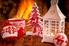 La Navidad cerca de la chimenea Imagen de archivo