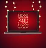 La Navidad con el ordenador portátil Imagenes de archivo