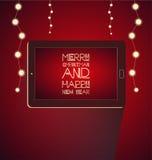 La Navidad con la tableta Imagenes de archivo
