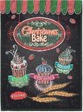 La Navidad cuece el diseño dibujado mano de la pizarra, hornada del día de fiesta, magdalenas lindas del Año Nuevo fijadas Imagen de archivo
