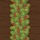 la Navidad de la decoración con la baya en fondo de madera Imágenes de archivo libres de regalías