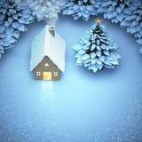 La Navidad de la nieve de la visión aérea la luz hacia fuera vuelve a casa la puerta y foto de archivo libre de regalías