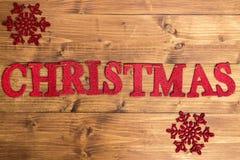 La Navidad de la palabra y copos de nieve grandes Fotografía de archivo libre de regalías