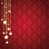 La Navidad de oro protagoniza los ornamentos rojos del fondo Fotos de archivo