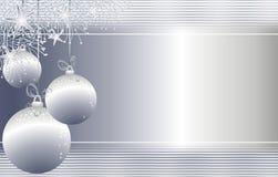 La Navidad de plata colgante adorna el fondo Foto de archivo libre de regalías