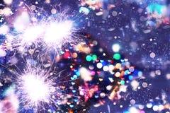 La Navidad del Año Nuevo Fondo abstracto, bokeh, luces de Bengala, chispas Fotos de archivo
