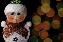 La Navidad del bokeh del muñeco de nieve Fotos de archivo libres de regalías