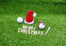 La Navidad del golf con la pelota de golf y la decoración de la Navidad imagen de archivo