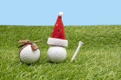 La Navidad del golf con la pelota de golf y la decoración de la Navidad imagen de archivo libre de regalías
