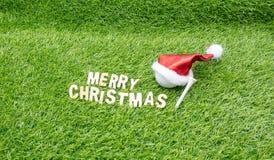 La Navidad del golf con la pelota de golf y la decoración de la Navidad imágenes de archivo libres de regalías