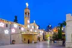 La Navidad en el cuadrado bien de Maria, Nazaret Foto de archivo libre de regalías
