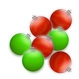 La Navidad en verde y el rojo - ornamentos del día de fiesta Foto de archivo