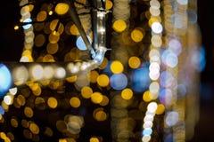 La Navidad Fondo abstracto festivo con las luces y las estrellas defocused del bokeh Fotografía de archivo
