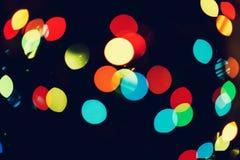 La Navidad, fondo del Año Nuevo con el bokeh hermoso de la guirnalda colorida se enciende Foto de archivo