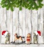 La Navidad juega el fondo de madera rústico de la decoración Fotografía de archivo