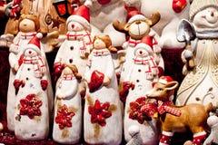 La Navidad juega, Papá Noel, reno, muñeco de nieve 1 Foto de archivo