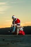 La Navidad mún santa en la chimenea Fotos de archivo libres de regalías