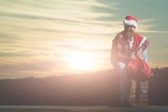 La Navidad mún santa en la chimenea Fotografía de archivo libre de regalías