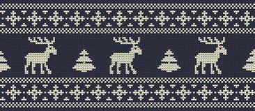 La Navidad Modelo hecho punto con los ciervos en un fondo azul marino Stock de ilustración