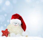 La Navidad Muñeco de nieve en el sombrero de santa Imagen de archivo