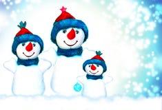 La Navidad, muñeco de nieve y familia Fotos de archivo libres de regalías