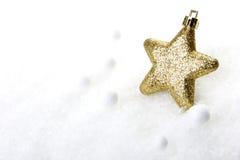 La Navidad, oro del ornamento de la Navidad imagenes de archivo