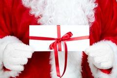 La Navidad Papá Noel con el regalo Imagenes de archivo