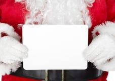 La Navidad Papá Noel con una tarjeta Fotografía de archivo