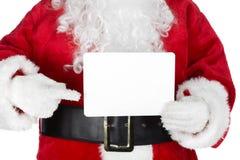 La Navidad Papá Noel con una tarjeta Fotos de archivo