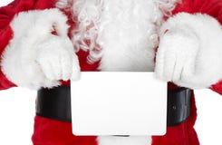 La Navidad Papá Noel con una tarjeta Fotografía de archivo libre de regalías