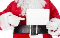 La Navidad Papá Noel con una tarjeta Fotos de archivo libres de regalías