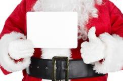La Navidad Papá Noel con una tarjeta Imagen de archivo