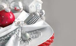 La Navidad roja y de plata adorna la frontera Imagen de archivo