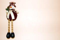 La Navidad rosada del fondo del muñeco de nieve Fotografía de archivo