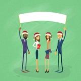 La Navidad Santa Hat Show White Board de los hombres de negocios Fotografía de archivo