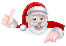La Navidad Santa Pointing Imagenes de archivo