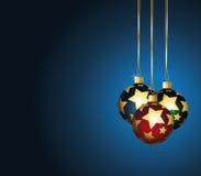 La Navidad stars los ornamentos en fondo azul. Imagen de archivo libre de regalías