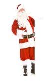 La Navidad: Tarjeta del blanco de Santa Stands Full Length Behind Fotografía de archivo libre de regalías