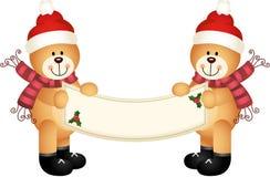La Navidad Teddy Bear Holding una muestra en blanco Fotos de archivo