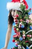 La Navidad traviesa adolescente foto de archivo