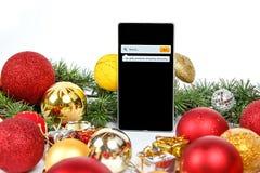 La Navidad y Año Nuevo que hacen compras en línea Foto de archivo libre de regalías