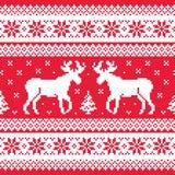 La Navidad y modelo hecho punto invierno con el reno Imágenes de archivo libres de regalías