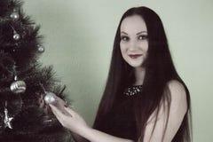 la Navidad y muchacha con el pelo recto Fotos de archivo