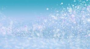 La neige abstraite de scintillement allume le fond de vert de mer Images libres de droits