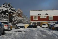 La neige a couvert des hoouses Photo stock